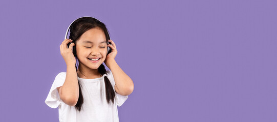 Asian Girl In Headphones Listening Music Standing In Studio, Panorama