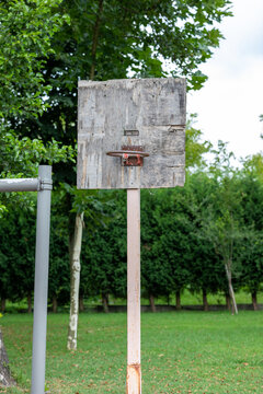 The old basketball hoop made of wood.