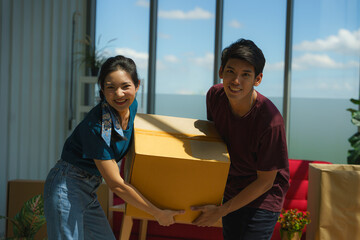 couple working together to unpacking from house moving and relocation