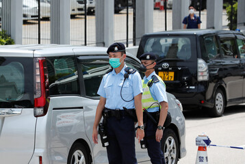 Police check vehicle at a roadblock as they search the headquarters of Apple Daily and Next Media after media mogul Jimmy Lai Chee-ying, founder of Apple Daily was detained by the national security unit in Hong Kong