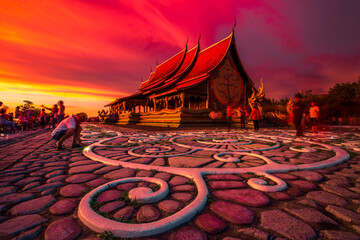 blurred abstract background of the twilight sky in the evening at one of the beautiful tourist spots in Ubon Ratchathani(Wat Sirindhorn Wararam)WatPhuPhrao,tourists always come see the glowing church.