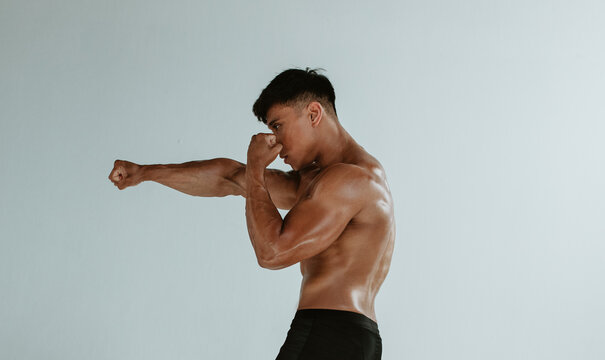Muscular man shadow boxing