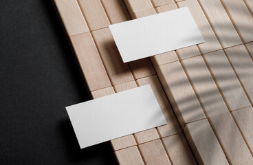 Minimal business card mockup with wooden block