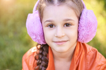 Funny young girl at park. Finish lockdown. Smile person. Schoolgirl portrait. Summer female portrait. Face. Attractive lifestyle. Purple headphones. Street smile. Listen music. Looking at camera