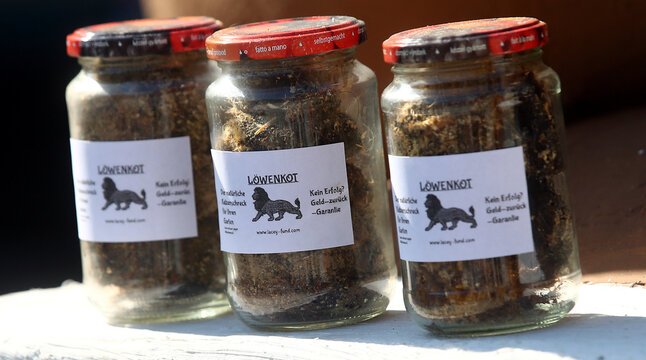 Jars of lion droppings are displayed in Munich