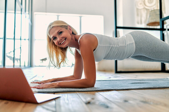 Senior woman doing sport at home