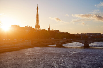 Cityscape of Paris, France and famous landmark Eiffel tower in silhouette just before sunset.