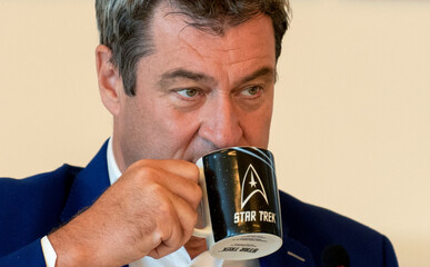 Bavarian State Prime Minister Markus Soeder drinks out of a Star Treck mug before a cabinet meeting in Nuremberg