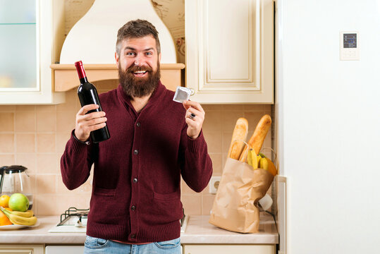 Bearded guy getting ready for a date. Man holding condom. Safety sex concept. Valentine's holiday.