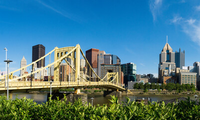 Pittsburgh Skyline with Blue Sky, Bridge, and Archtiecture.