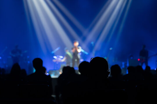 Texture blur and defocus entertainment concert lighting on stage,Integrated focus lights on the lead singer in the middle of the stage.