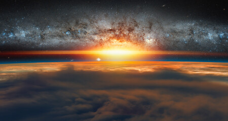 Wall Mural - View of the planet Earth from space during a sunrise against milkyway galaxy