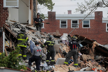 Rescue workers are seen at the scene of an explosion in a residential area of Baltimore