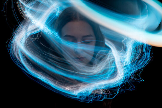 light painting portrait, new art direction, long exposure photo without photoshop, light drawing at long exposure