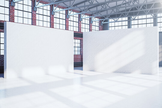 Large red brick hangar interior with two blank banners.