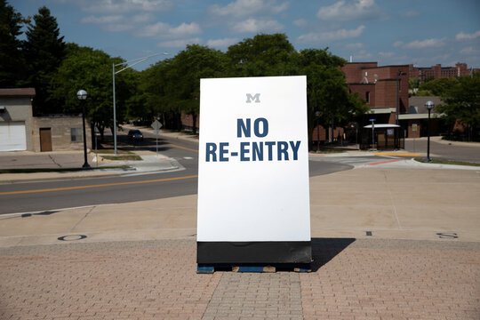 A no re-entry sign is displayed in front of Michigan Stadium on the University of Michigan campus amid reports of college football cancellation in Ann Arbor