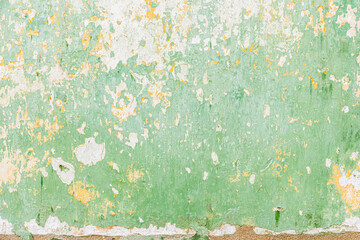 Old wall with peeling paint green
