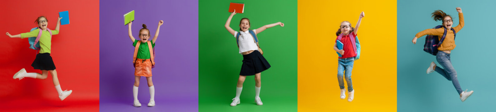 Kids with backpacks on colorful background