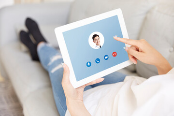 young asian business woman answering video call from businessman