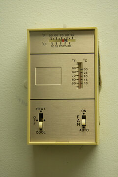 Close up of a manual wall mounted thermostat.