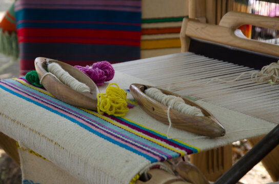 Wooden handloom for creating a handwoven woollen fabric