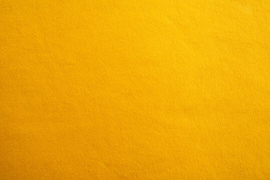Yellow cotton knitted fabric and ruler