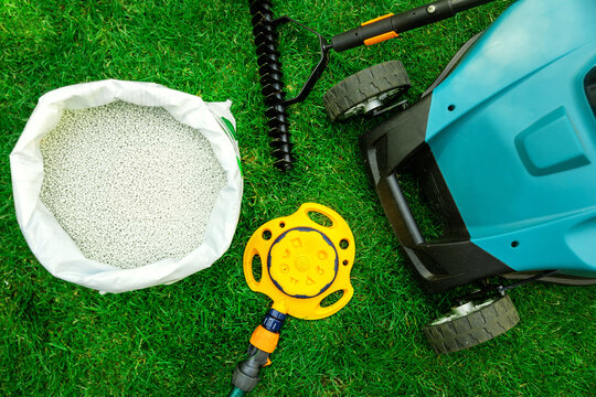 lawn care tools and equipment for perfect green grass. top view