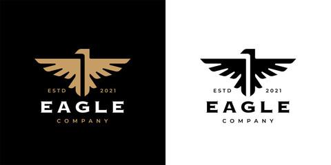 Eagle crest logo icon template design. Concept gold bird insignia business emblem. Premium company brand identity hawk symbol. Heraldic falcon in flight badge. Vector illustration.