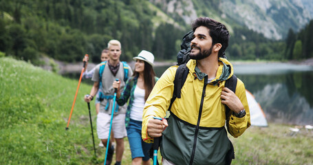Group of friends hiking together outdoors exploring the wilderness and having fun