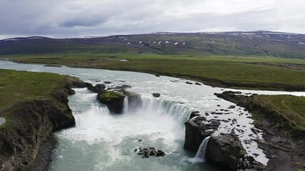 Wall Mural - Flying above the Godafoss waterfall in Iceland