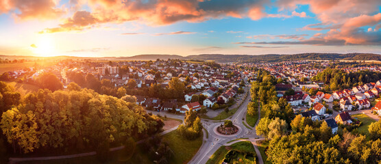 Fototapeta Aerial panorama of a European town at sunrise, with magnificent colorful sky and warm light obraz