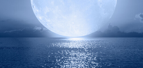 Wall Mural - Night sky with blue full moon in the clouds on the fore ground calm blue sea