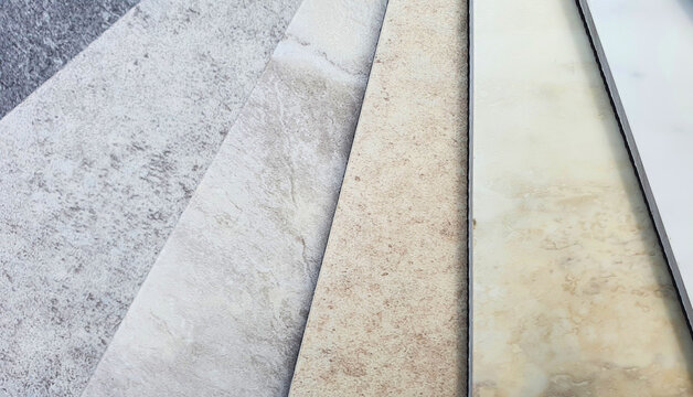 printed stone and concrete vinyl floor tile samples contains grey concrete and beige travertine marble pattern. interior floor covering material for architectural construction.