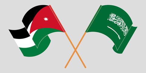 Crossed and waving flags of Jordan and the Kingdom of Saudi Arabia
