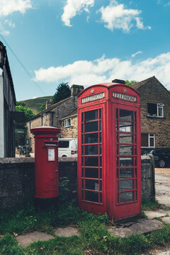 Centre of Edale small village at Peak District National park, England, UK with iconic red telephone booth and mailbox