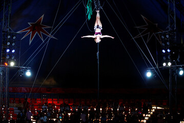 """An acrobat performs at the Zippos Circus during the show called """"Rebound!"""" on its opening night, in Brighton"""
