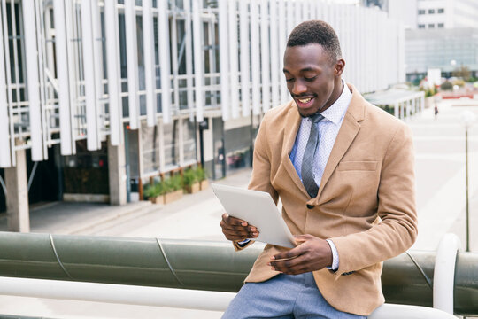 Young businessman using a tablet in the city