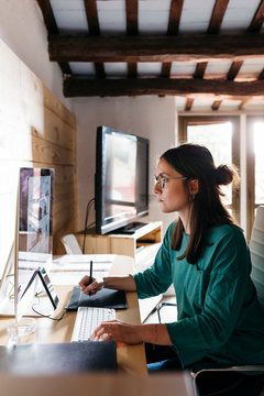 Female architect using computer at home