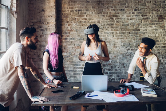 Creative team using Vr goggles in loft office