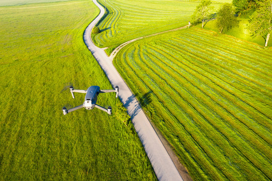 Germany, Bavaria, Icking, Drone flying over countryside dirt road
