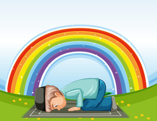 Arab muslim boy in traditional clothing praying on rainbow background