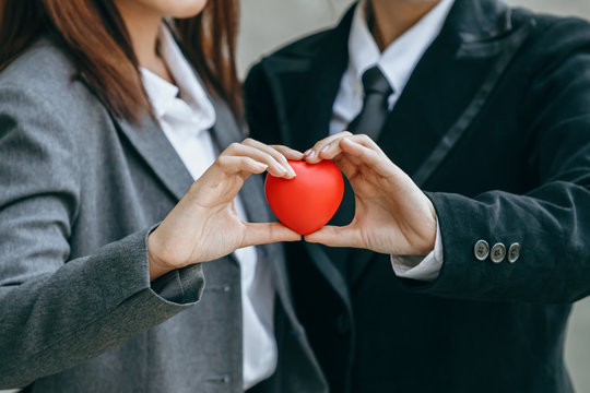 Close up hands holding red heart in world heart day concept.
