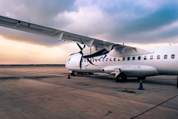 airplane at the airport Fotobehang