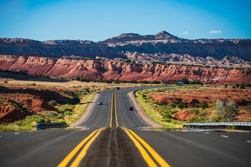 Natural american landscape with asphalt road to horizon.