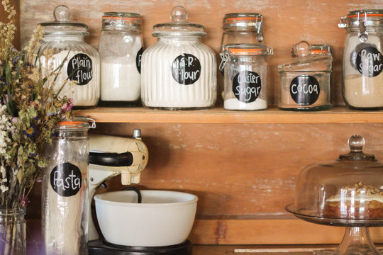 Baking Ingredients displayed on an antique kitchen hutch. A stylish way to store your staples like flour, sugar etc.