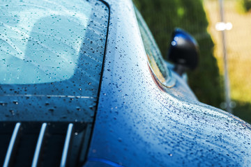 Wet Clean Modern Car Body Close Up