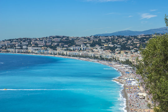 Wonderful panoramic view of Nice with colorful historical houses, seacoast and sea from Cimiez hill. Nice - luxury resort of Cote d'Azur, France.