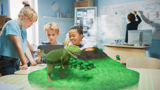 3 Diverse School Children Use Digital Tablet Computer with Augmented Reality Software, Looking at Educational 3D Animation - Dinosaur on Island with Active Volcano. VFX, Special Effects Render