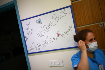 A sign welcoming patients hangs on the wall of the dialysis unit at the Lebanese Hospital Geitaoui in Beirut