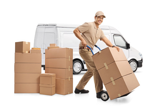 White delivery van and a male worker loading boxes